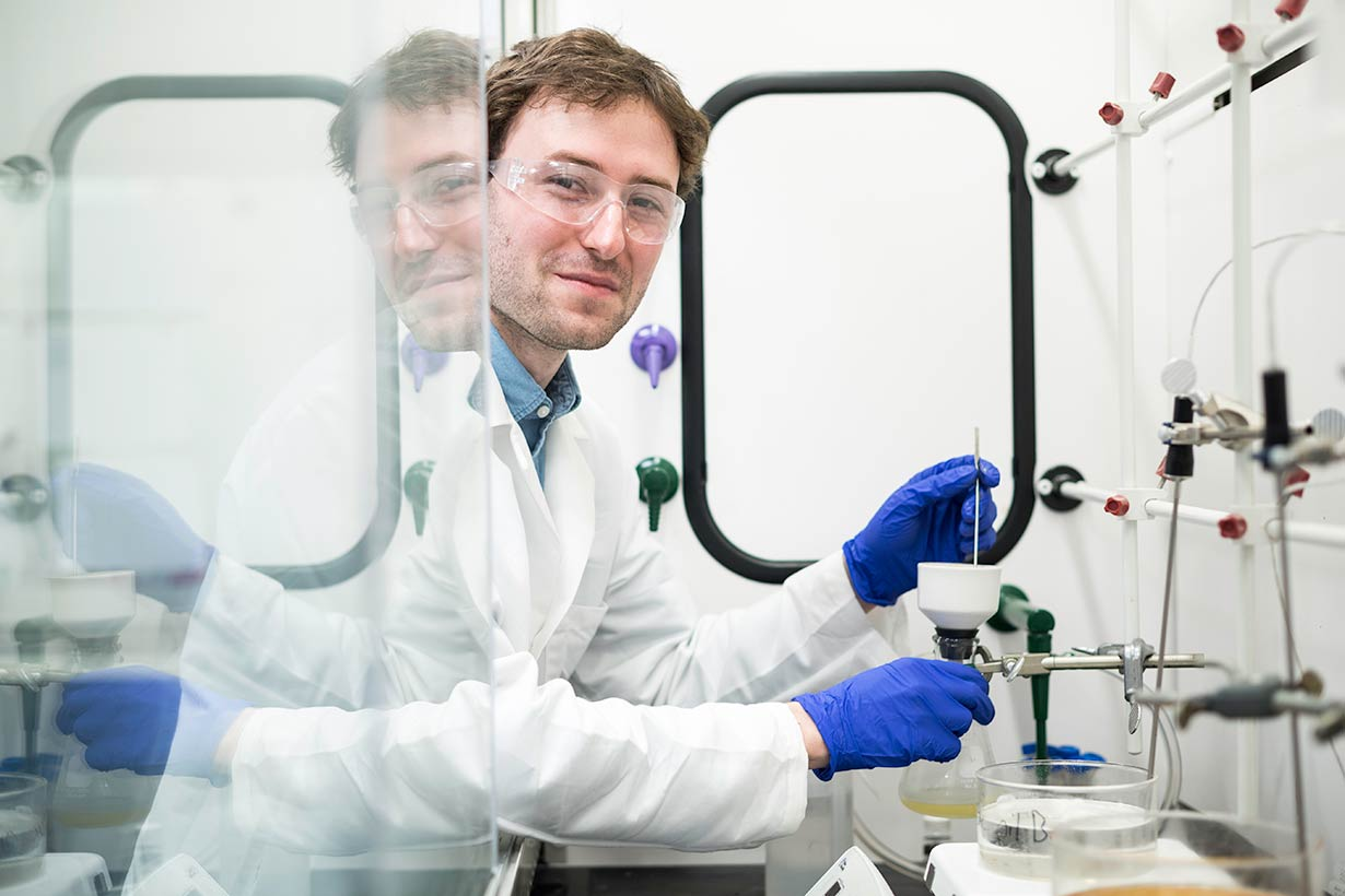 Take Five student Austin Bailey is pictured in the lab of chemistry professor Todd D. Krauss.